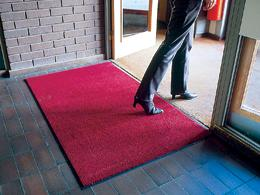 The red Entraplush entrance mat in use in an office reception