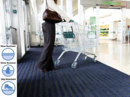The premier track entrance mat in use in a supermarket