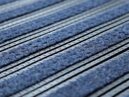 Close up of this easy clean mats' PVC and carpet inlay