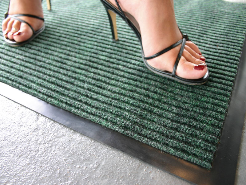 carpet mat. the ribbed entrance mat in action an office reception carpet
