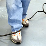 Avoid trip hazards by using floor covers and cable protectors